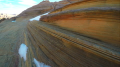 Panning view along the sandstone past some snow. Stock Footage