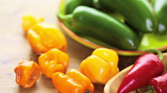 Variety of fresh organic peppers on the table. Stock Footage