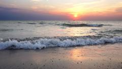 Sunset on the beach - Tranquil idyllic scene of a golden sunset over the sea, Stock Footage