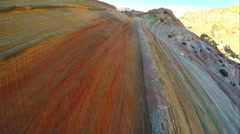 Gliding over the stripes in the sandstone near the Wave. Stock Footage