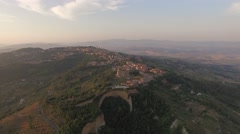 Aerial view of Italian town Volterra during sunrise in Tuscany Stock Footage
