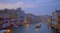 View from Accademia Bridge after sunset in the lagoon city of Venice in Italy Stock Footage