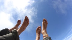 Feeling relaxed and letting the bare feet air out in  the sun Stock Footage
