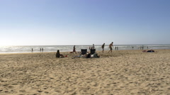 Wide shot of people at the beach Stock Footage