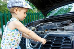 Gifted kid repairing car engine Stock Photos