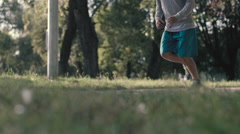 Lone runner in park, slow motion shot at 240fps Stock Footage