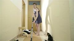 Cute cat helping woman vacuuming home 4K Stock Footage