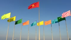 Many colour flags in blue sky Stock Footage