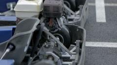Go-karts standing on start line Stock Footage