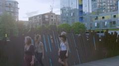 Friends walk along park path Stock Footage
