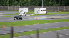 Safety training for car drivers on polygon - stock footage