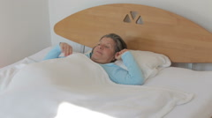 woman in her 50s waking up in the morning and looks happy - stock footage