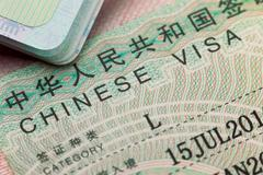 Chinese visa in a passport - enjoy travel - stock photo