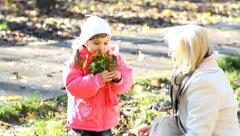 Mom and daughter making autumn bouquet of flowers yhen smelling it Stock Footage
