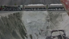 Freight train pours asbestos dust Stock Footage
