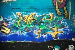 Paint tins and graffiti Stock Photos