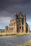 Whitby Abbey lit by the sun - stock photo