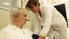 Nurse / pharmacist ends to measure the pressure of a sick man Stock Footage