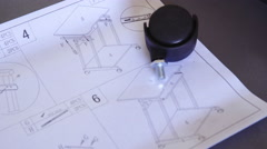 Instructions to build a table with wheels close up 4K Stock Footage