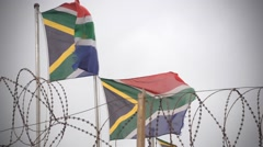 Tattered South African flags blowing in the wind Stock Footage