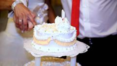 Anonymous wedding couple cutting and folding plates on the wedding cake - stock footage