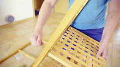Screwing shelf on wooden frame close up 4K - stock footage