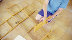 Top view of wooden frames on home floor 4K Stock Footage
