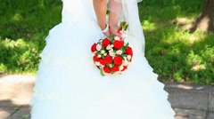 beautiful wedding bouquet of flowers in hands of young bride - stock footage