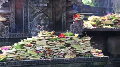 Balinese offerings to gods in Bali with flowers, money and aromatic sticks Stock Footage