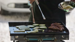 Clumsy cook doing barbecue close up - stock footage
