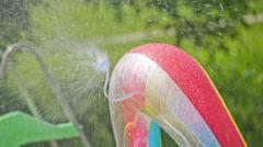 Water sprinkler on inflatable kid pool - stock footage