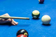 billiard cue and balls - stock photo