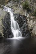 A waterfall in a mountain creek in the High Fens, Ardennes, Belgium, long exp Stock Photos