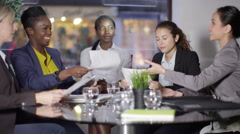 4k Female business group in a meeting - Lady boss watches over her team Stock Footage