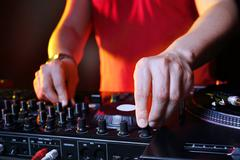 Mixing console, DJ job in the disco - stock photo