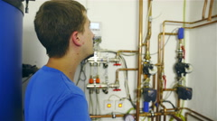 Man checking and setting water pipes system 4K Stock Footage