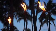Tiki Torches Burning on Waikiki Beach at Night Stock Footage
