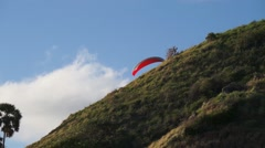 Hanglider moving near a hill slope Stock Footage