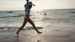 Summer girl with hat, beach freedom happy concept. Young girl running on ocea Stock Footage