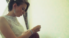 the bride puts on her bracelet for wedding slow motion - stock footage