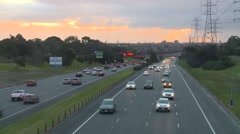 Traffic on Freeway at Sunset (Timelapse) Stock Footage