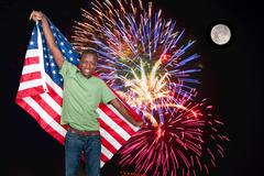 Stock Photo of Fireworks at Full Moon