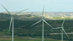 Alternative energy generation, nature conservation. Wind turbines, green hills Stock Footage