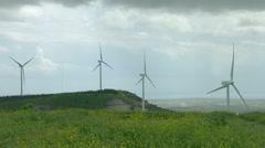 Wind turbine propellers spinning in wind, windmills in beautiful green field Arkistovideo