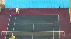 Man Playing Tennis Outdoors Stock Footage