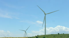 Wind turbines rotate, amazing blue sky background, alternative energy innovation - stock footage