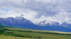 Clouds moving over Altai mountains, zoom in, 4k Stock Footage