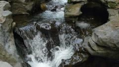 Pan Down Following Forest River Waterfalls Under Bridge Stock Footage