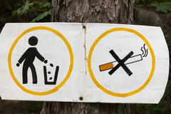 Sign Smoking and littering are prohibited. - stock photo