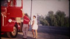 2447 - man shows wife new 18 wheeler truck - vintage film home movie - stock footage